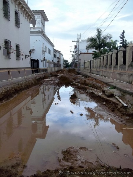 The sky reflecting in the water left from the rains that filled the street Isabel la Catolica during Renovada Ciudad Colonial project.