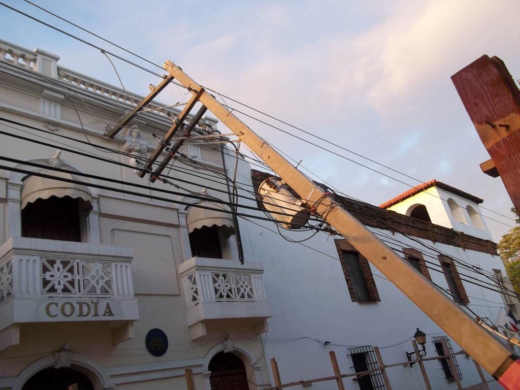Poles against the CODIA building.