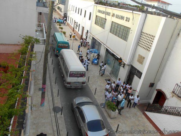 Busses line Calle Isabel la Católica bringing people to honor Mother Teresa.