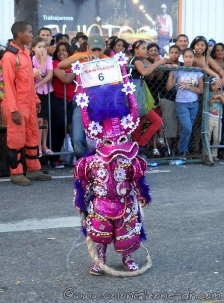 Carnival Santiago with a young whip-cracking Lechone